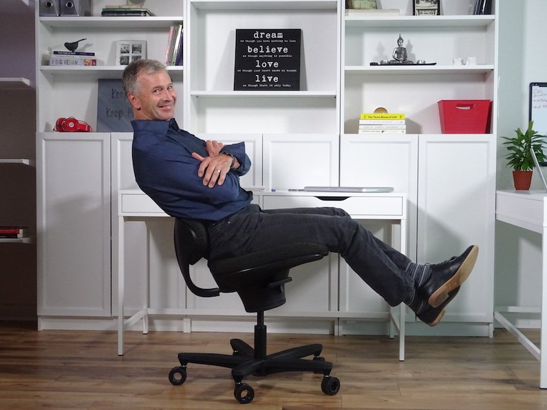 man leaning back on an ergonomic office chair