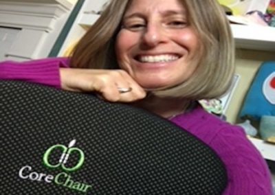 lady smiling with her corechair